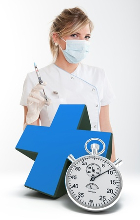 latex girl:   Female dentist holding a syringe, a blue cross and a chronometer