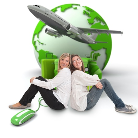 A pair of female friends with an online international travel booking background photo