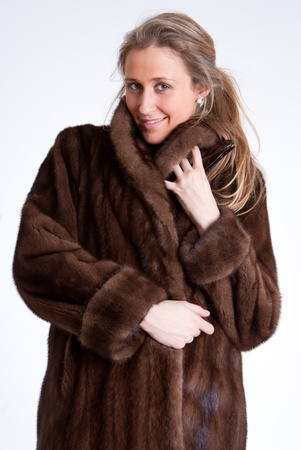 Young woman wearing a mink coat photo