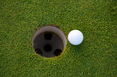 Golf ball and hole  aerial view photo