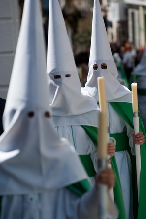 semana santa: Penitents holding candles in Spanish Semana Santa Easter celebration Editorial