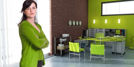 Woman standing in an office in green shades photo