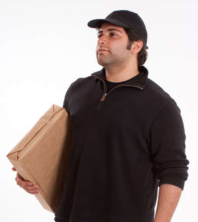 stubble: Portrait of a young man carrying a cardboard box