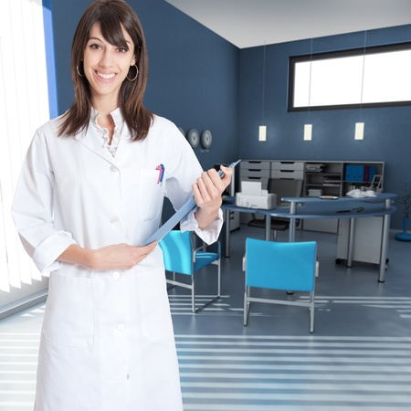 Smiling young woman wearing a lab coat in an office interior