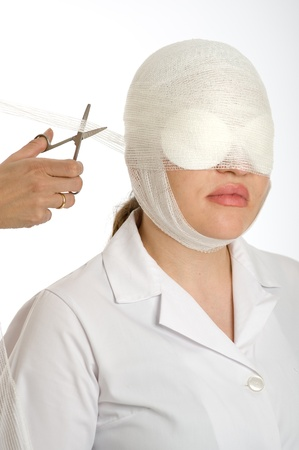 Woman with a face surgery in the process of changing the bandage  photo