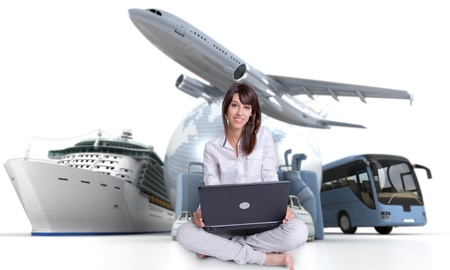 booking: Young woman sitting on the floor with a laptop with an international tourism background
