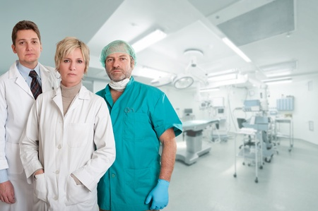 serious doctor: Medical team, with surgeon, anesthetist and nurse in an operating room