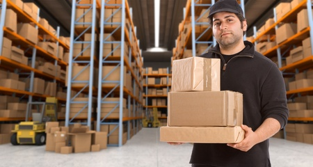 messenger: Deliveryman carrying a parcel in a distribution warehouse
