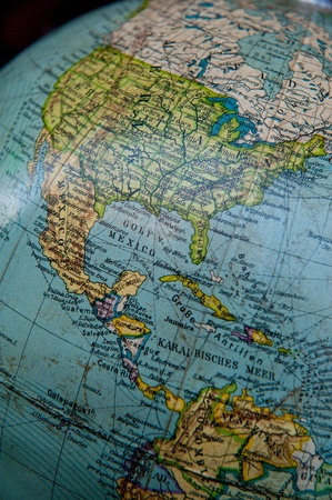 Close up shot on a vintage world globe focused on Caribbean and central America photo