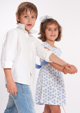 Little brother and sister walking hand in hand