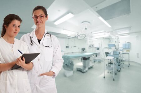 Female doctor and nurse in an operating room Stock Photo - 13354588