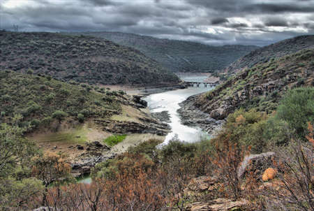 Spanish landscape with river on a stormy day Stock Photo - 13354770