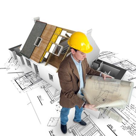 architect drawing:   Architect looking at his plans with a house in construction and blueprints   Stock Photo
