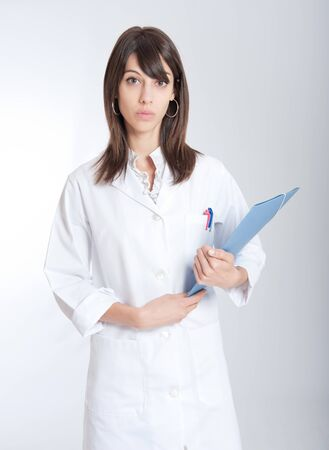 admissions:  Standing young medical worker holding a folder