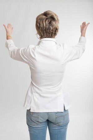 Rear view of a woman showing something with both hands   Stock Photo - 13354525