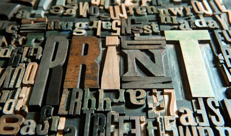 lithograph: Background of vintage wooden letter cases with the word print  Stock Photo