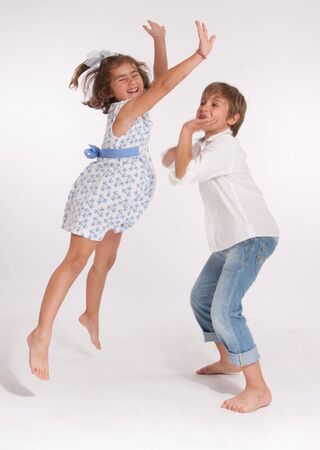 A young boy and a little girl happily playing Stock Photo - 13441559