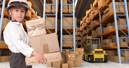 Child wearing a motorbike helmet carrying parcels in a transportation warehouse Stock Photo - 13441859