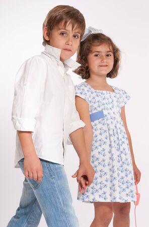 A young boy and a little girl holding hands photo
