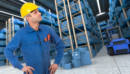 Man with helmet and blue overalls in a distribution warehouse photo