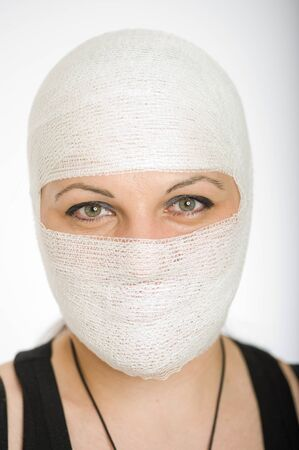 eye mask:  Portrait of a woman with a bandaged head and face