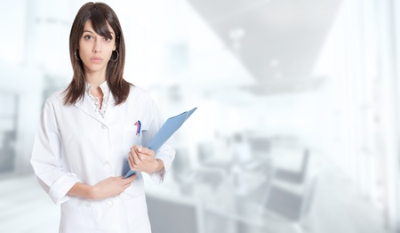 heal care: Standing young medical worker holding a folder