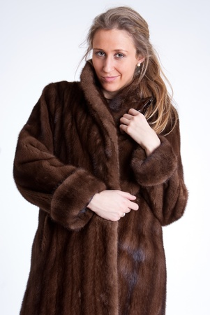 bimbo: Young woman wearing a mink coat