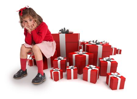 Sad little girl sitting surrounded by gift boxes  photo
