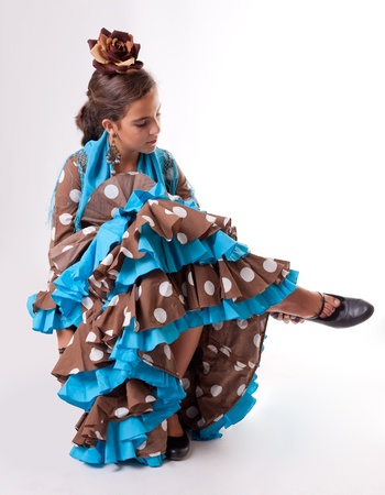 gipsy: Young Spanish dancer putting on her shoe Stock Photo