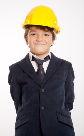 Young boy in school uniform wearing a yellow safety helmet  Stock Photo - 13734518