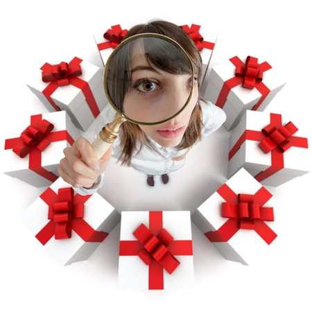 compare: A woman looking through a magnifying lens surrounded by presents