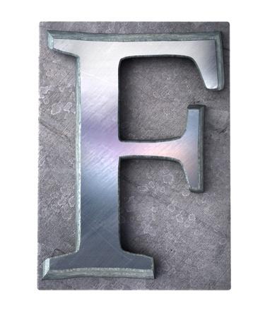 typescript:  3D rendering an upper case F   letter in metallic typescript print (part of a matching alphabet)  Stock Photo