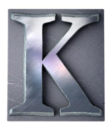 3D rendering an upper case K   letter in metallic typescript print (part of a matching alphabet)  photo