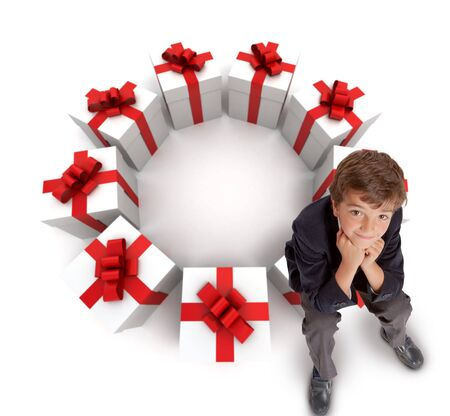 Little boy sitting on a circle of presents, Aerial view photo