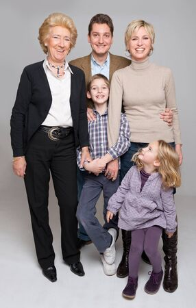 Portrait of  a family including parents, a boy and a girl and the grandmother  photo