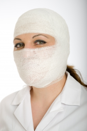 Portrait of a woman with a bandaged head and face   photo