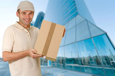 financial district: Friendly courier with lots of boxes in a financial district