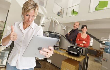 Happy people in a modern beautiful office Stock Photo - 13953921