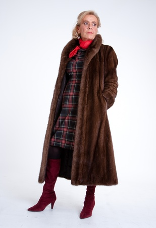 Senior lady wearing a mink coat photo
