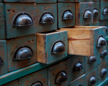filing: Close up shot on an apothecary chest with open drawers Stock Photo
