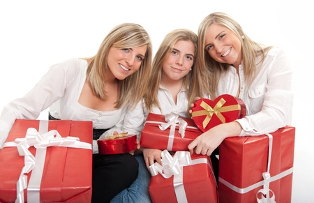 Three young sisters surrounded by gift boxes, some of them heart shaped Stock Photo - 14300610