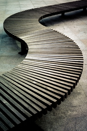 boarded: Curved wooden boarded bench