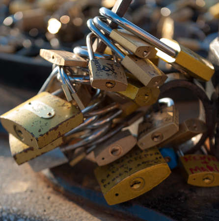 Multiple lover�s Padlocks attached to an iron  photo