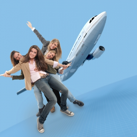 joking: A group of happy girls celebrating an airplane travel Stock Photo