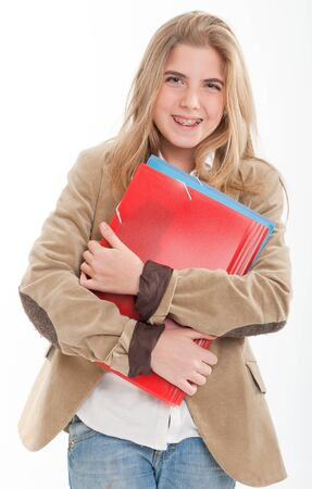 Laughing female teenager holding a pair of files  photo