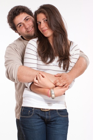 teen couple:  Teenagers couple in a tender embrace isolated on white