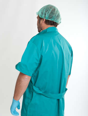 Rear view of a man in surgeon clothes  photo