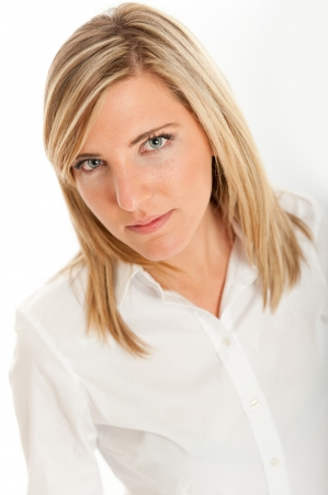 Portrait of an attractive blond girl with a serious expression  Stock Photo - 14715298