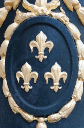 lys: Detail of a medallion with fleur de Lys Stock Photo