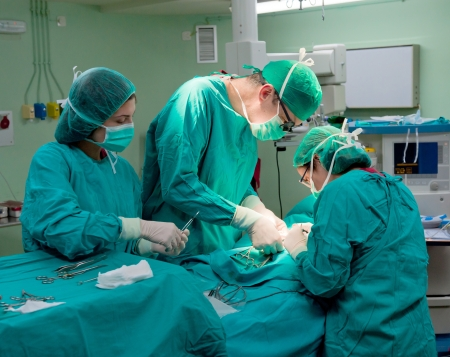 doctor mask: Medical team performing a pediatric surgery